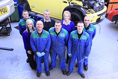 Group photo taken for a car repair business